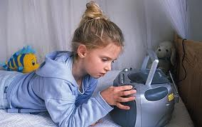 Photo represents how I looked when I was glued to my radio and cassette player in my pre-teens :-)