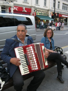 Musicians can be found around and they'll play for  pennies or a pound. Nice musical instrument, sir. :-)
