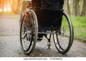 stock-photo-back-view-of-young-woman-in-wheelchair-during-walk-in-park-in-sunny-day-275636621